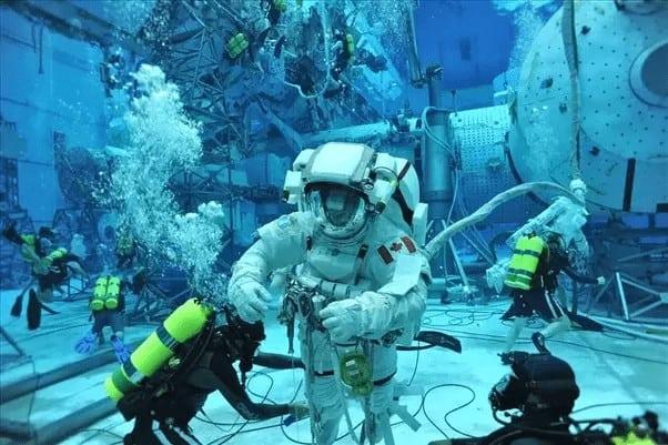 Astronaut training under water